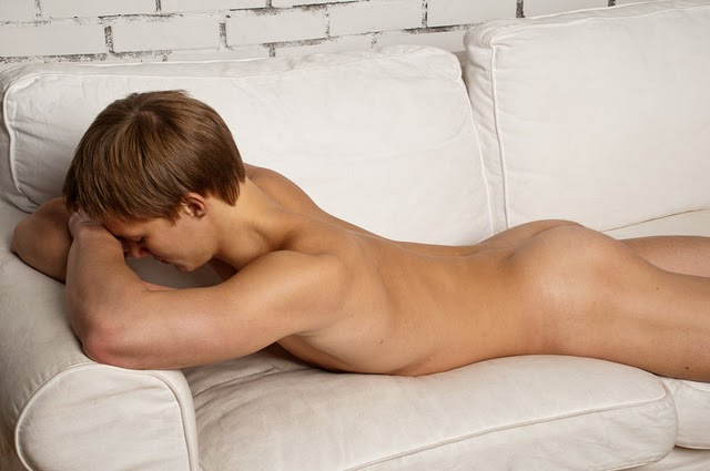 young nude boy on a couch